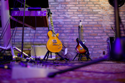This is a picture of two nice guitars on a stage.